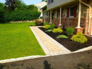 landscaping with pavers in front yard