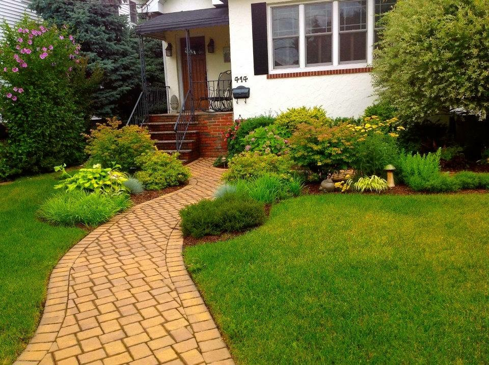 paver steps and landscaping in front of house