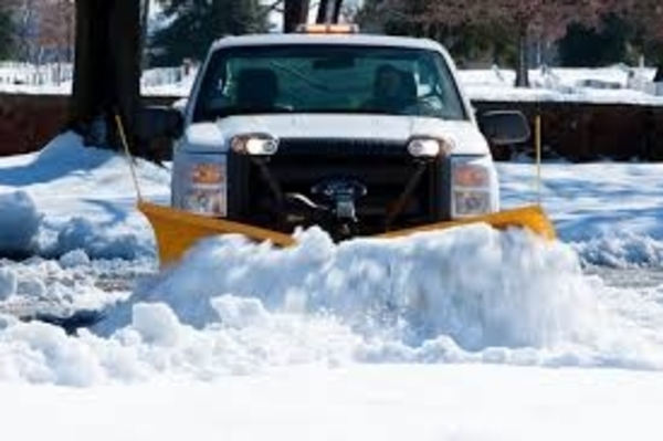 white snow plow truck